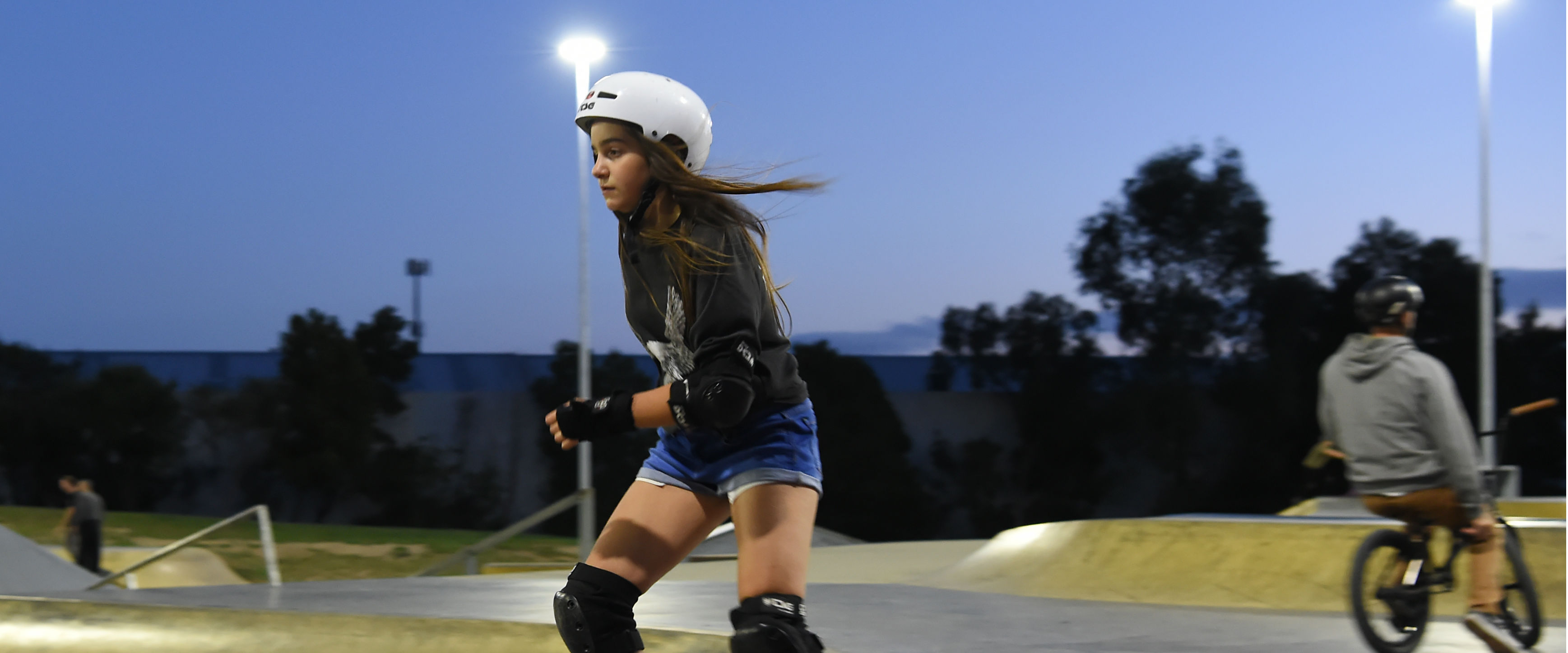 Young girl rollerblading at Box Hill Skate Park