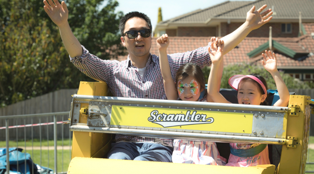 a man and two young girls on a ride
