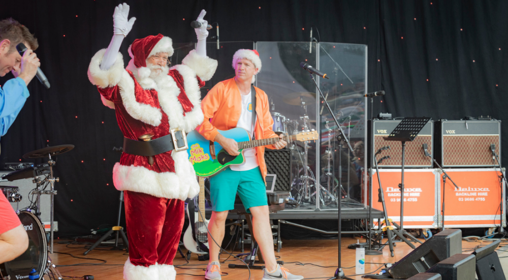 Santa Claus with musicians on stage