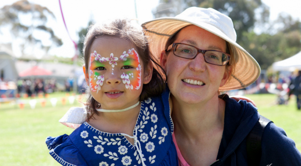 a lady and a young girl with face paint