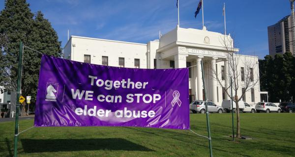 Town Hall with No excuse for Elder Abuse sign