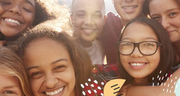 Teens, smiling in a group photo