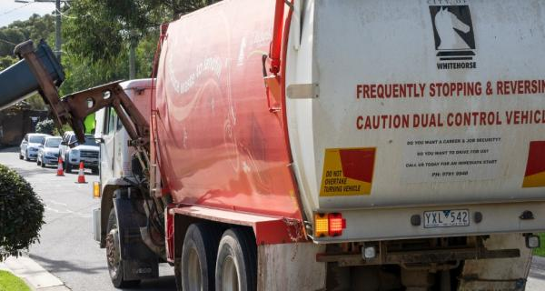 Image of truck collecting bins