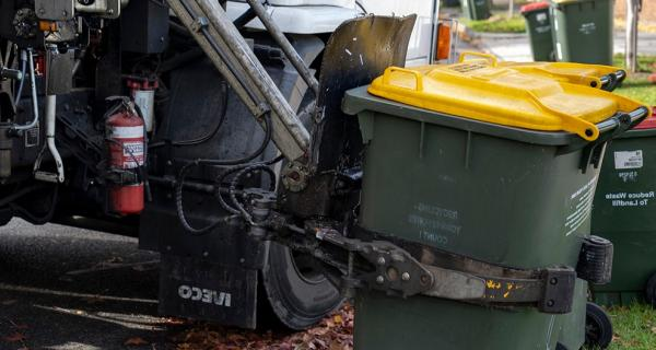 Image of truck collecting recycling bin