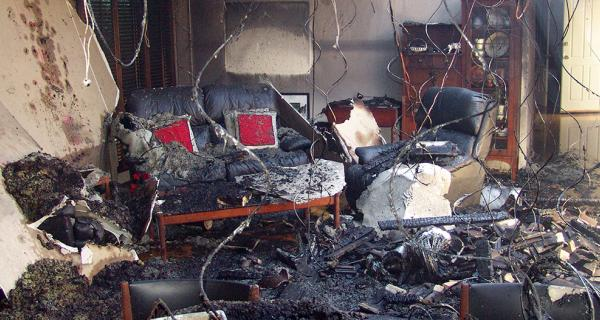 Lounge room damaged by fire
