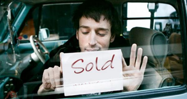 sold sign in car