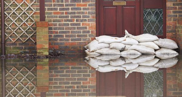 sand bags against a door preventing flood water entering
