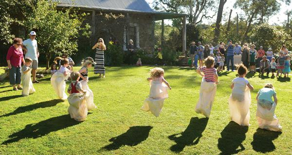 A group of children in a sack race at Schwerkolt Cottage