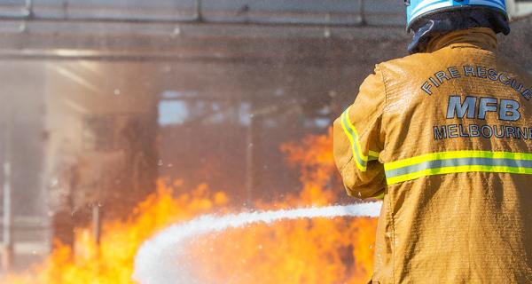 An MFB fire brigade officer fighting fire