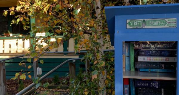 Neighbourhood house with street library at front