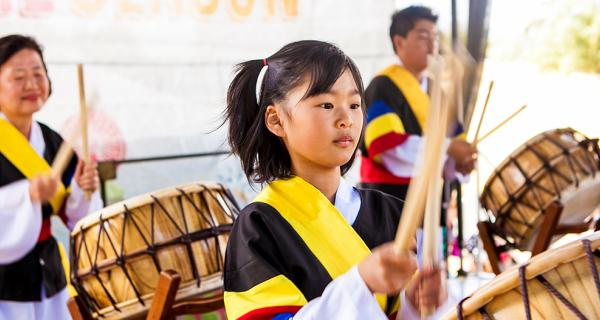 Kids playing traditional drums