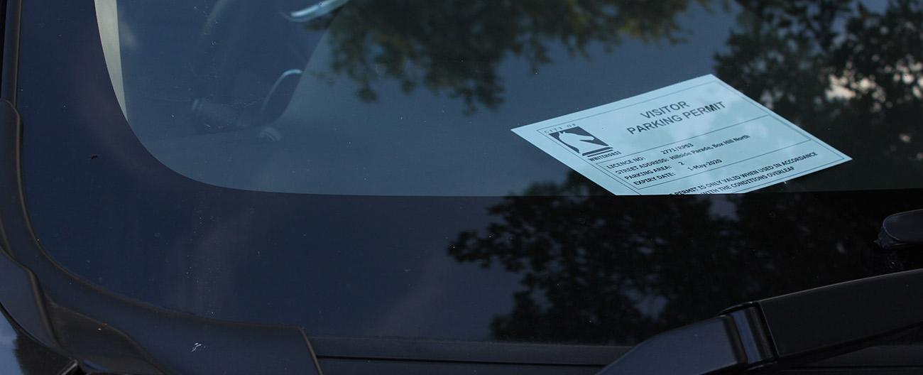 Visitor parking permit in windscreen