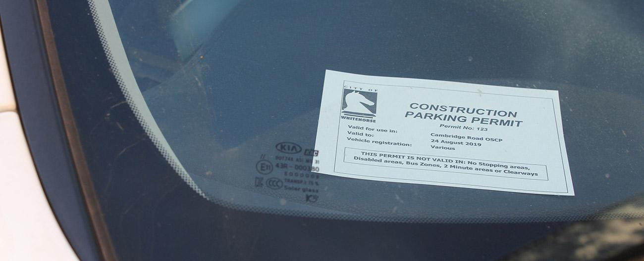 Construction parking permit in windscreen