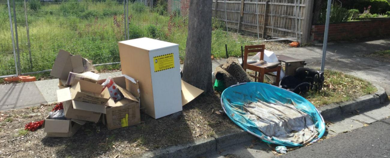 Dumped rubbish in front of vacant block