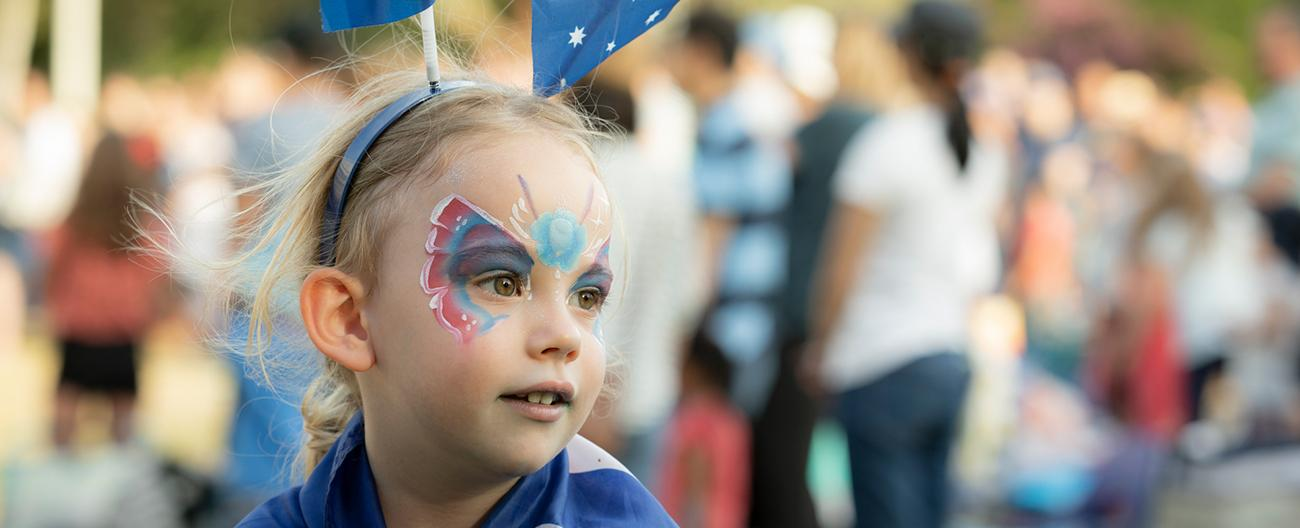 Child with face painted at an event